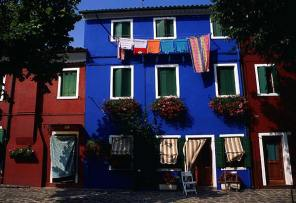 014_blue-house-and-red-flowers